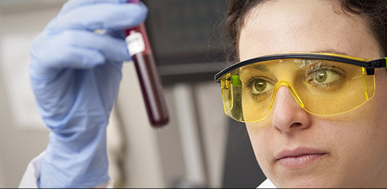 female scientist examining a blood sample
