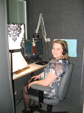 young woman in a recording studio wearing headphones