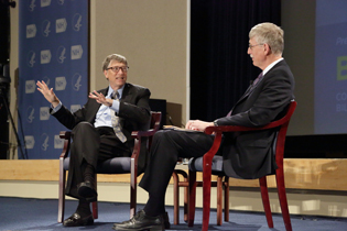 Bill Gates and Francis Collins sitting on stage