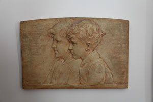 Bas-relief on stone of two boys in profile