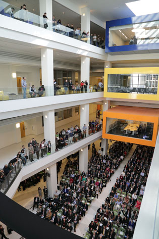 People line the balconies in the 4-story atrium