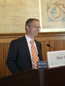 Peter Fisk at a podium