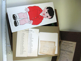 card with illustration of little boy; vocabulary test; other items