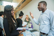 Johnetta Saygbe (left) talking to one of the recruiters