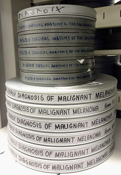 stack of metal film containers