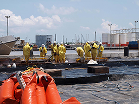 penmen working on the docks cleaning up the oil dispersants (see caption)