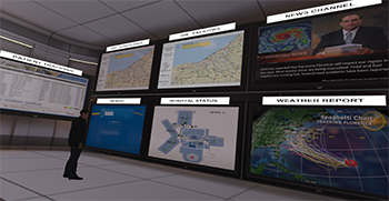 simulation of a crisis center with wall-size TV screens showing weather maps and information