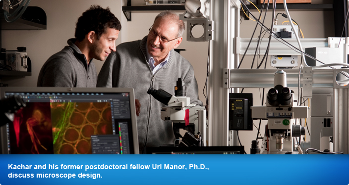Kachar and his former postdoctoral fellow Uri Manor, Ph.D., discuss microscope design.