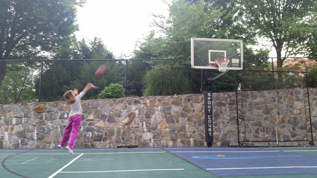 Mia playing basketball