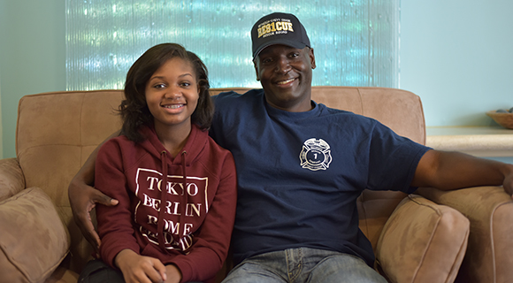 Terran (left) and her father, Terrence, at the Children's Inn at NIH