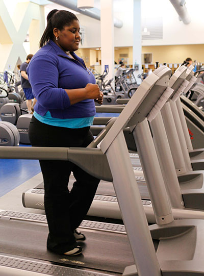 women exercising on treadmill