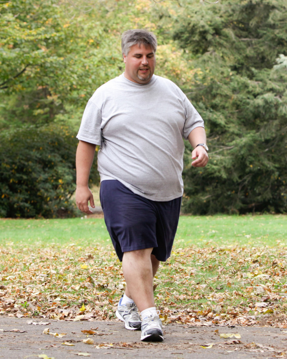 a man with obesity walking in the park