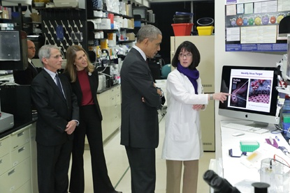 Dr. Sullivan (far right) gives President Barack Obama a tour of her lab