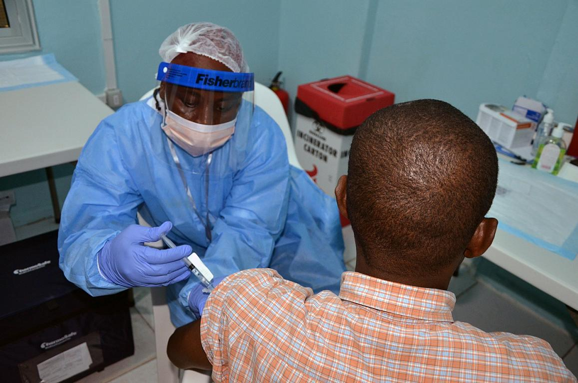 A volunteer receives an injection in the PREVAIL Ebola vaccine clinical trial in Liberia.