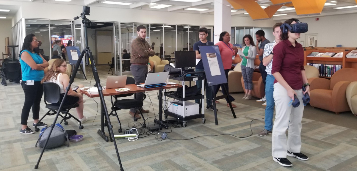 Members of Dr. Persky's group demonstrate virtual reality technology in the NIH Library
